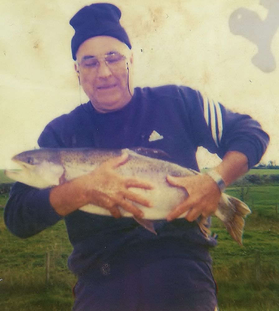 My Dad with a 14 and a 1/2 rainbow trout (released unharmed) by pepper012345