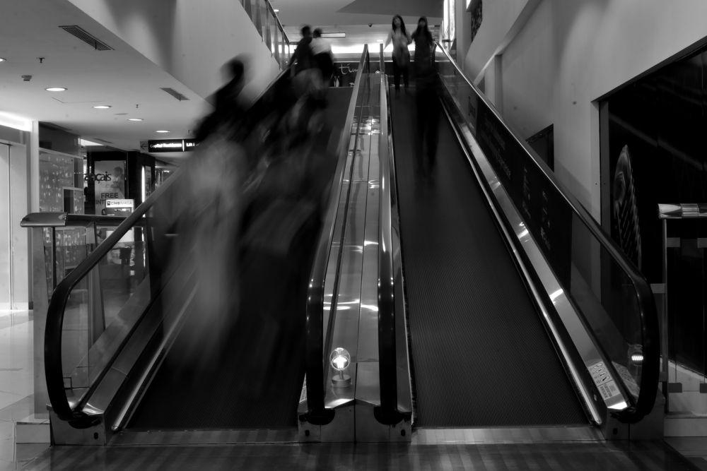 Busy Escalators by Yulius B Susilo