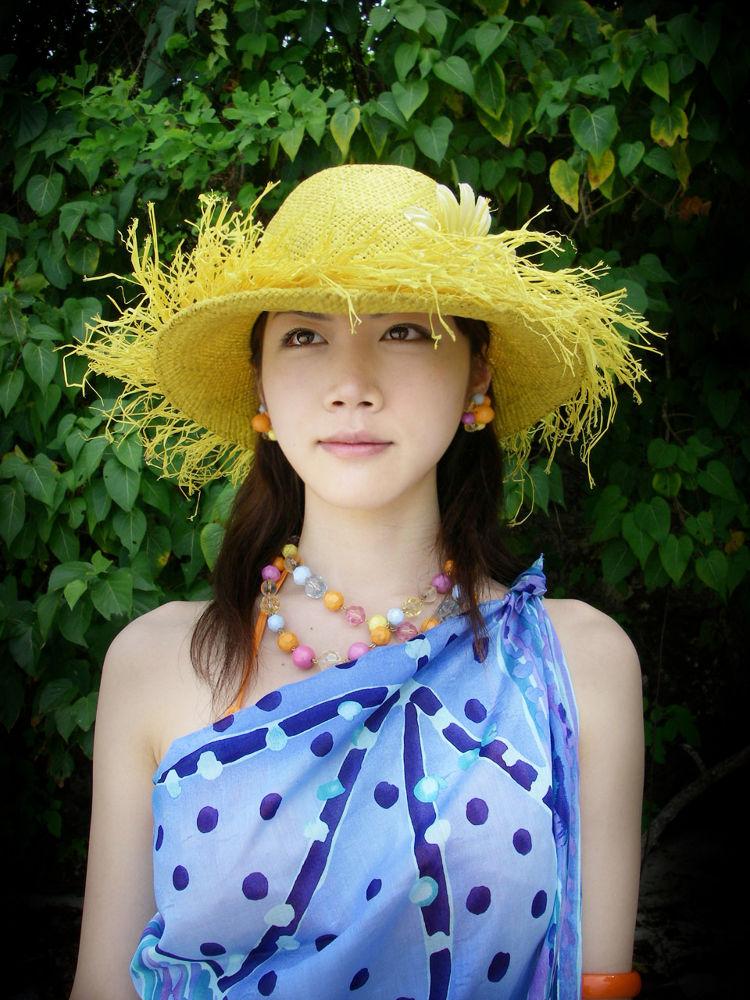 Yellow straw hat by Yosuke Ito