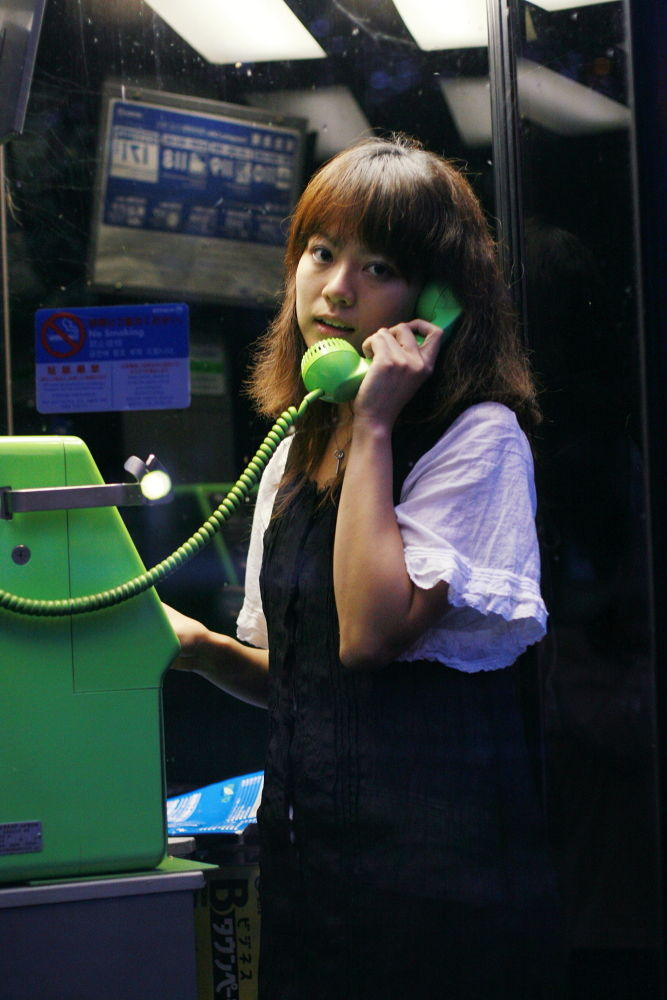 Photo in Portrait #girl #phone booth #night