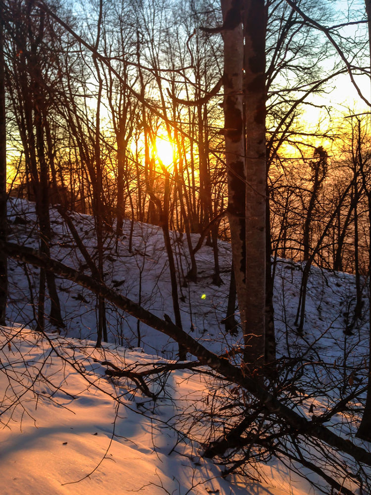 Sunset in snowy mountains by Faik Nagiyev