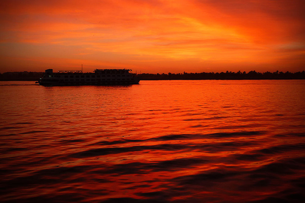 Photo in Travel #nile #sunset #egypt #egyptian #red #boat #reflection #dave hare