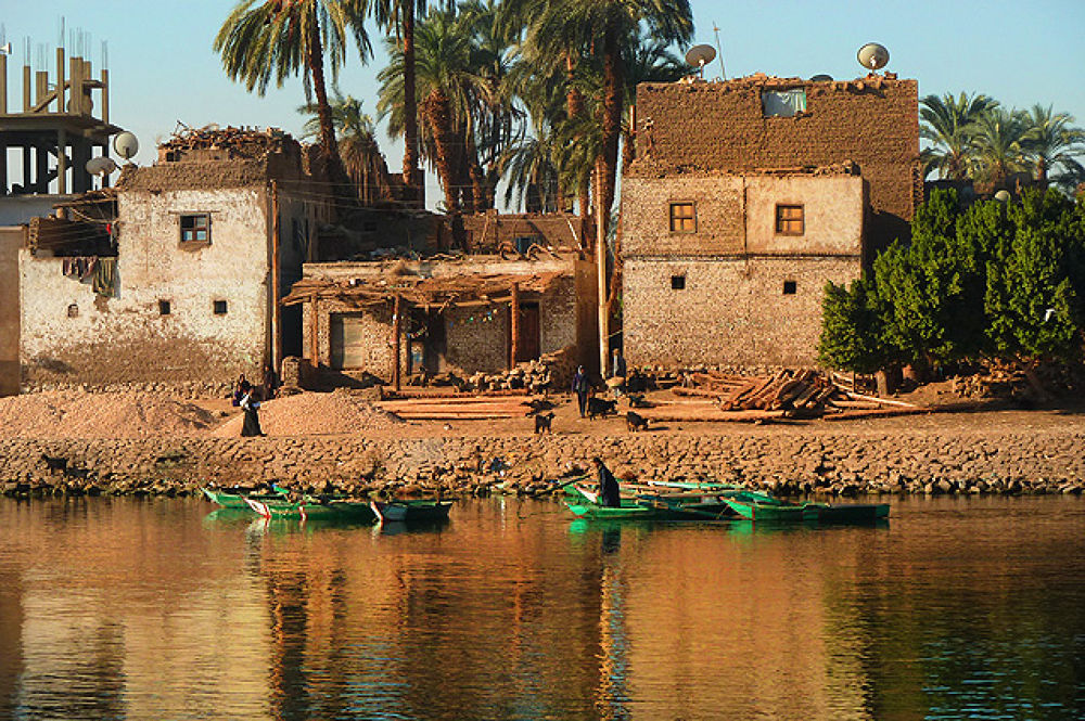 Photo in Architecture #nile #house #houses #egypt #egyptian #dave hare #reflection #reflections #boat #boats #ruin #ruins #derelict