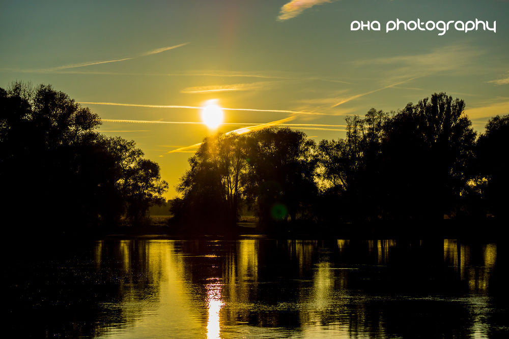 Photo in Landscape #vanilla #sky #sun #river #autumn #contrails