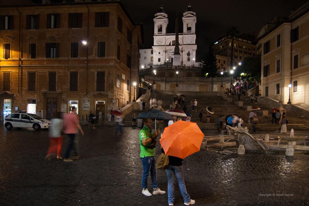 Orange umbrella by Pawel Gerula