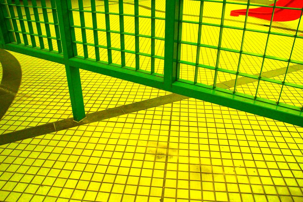 Photo in Abstract #fence #yellow #green #red