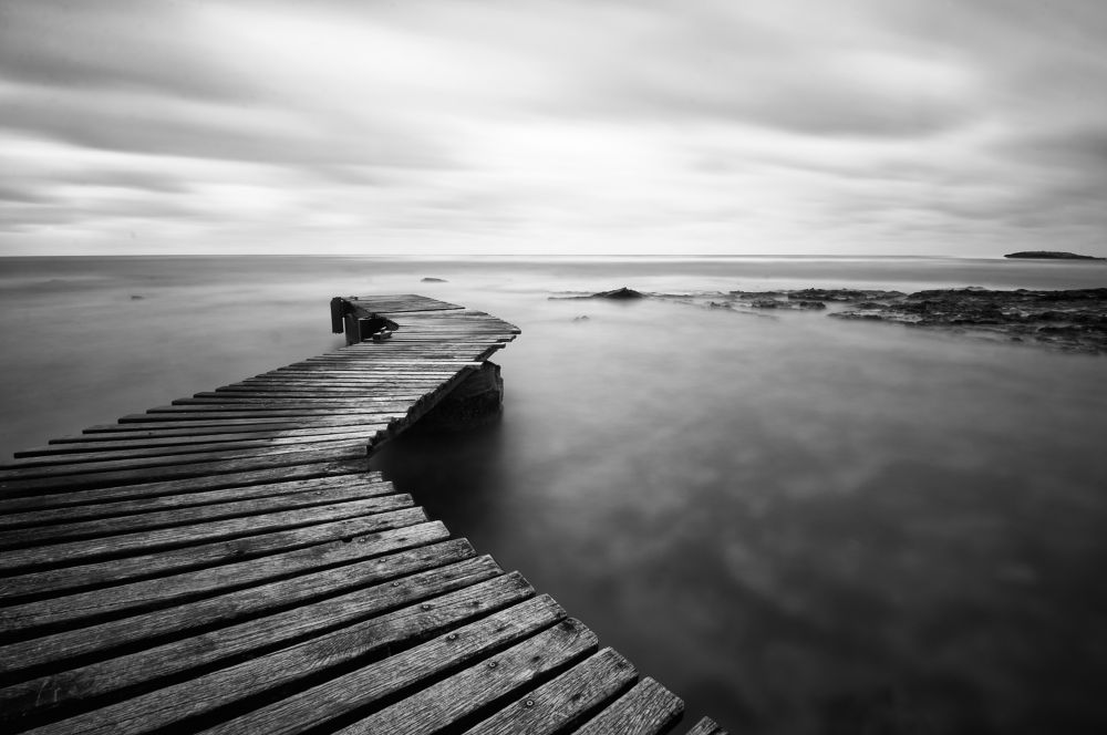 Photo in Black and White #black and white #long exposure #nature #sea #landscape #dock #pier #clouds #seascape #shore #italy #sardinia