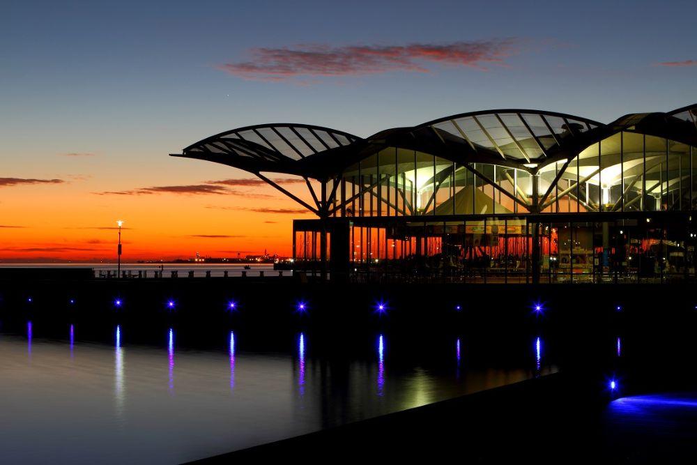 Photo in Landscape #corio bay #geelong #victoria #carousel #sunrise #dawn #orange #clouds #lights #bay #building #roof #pier #jetty #eastern beach