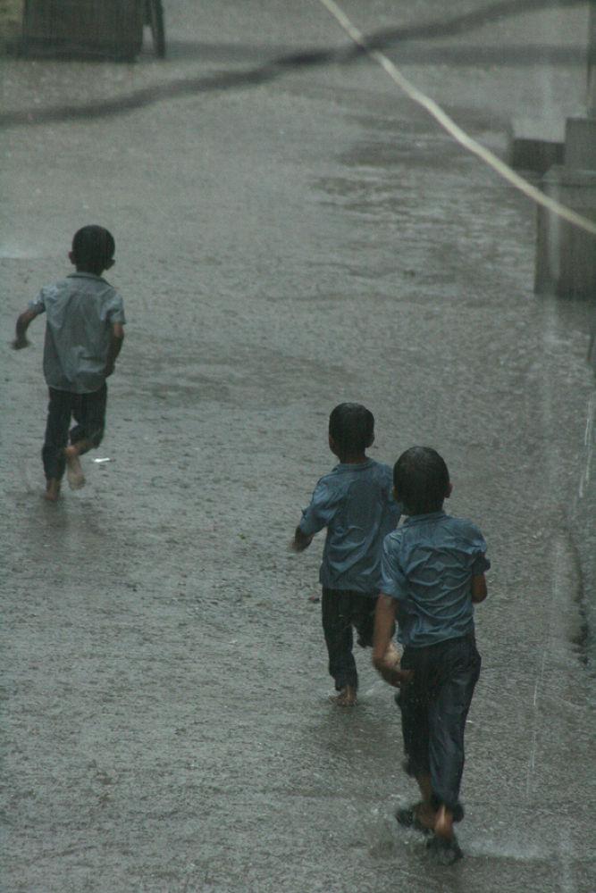Rain with childran by somil k. makadia