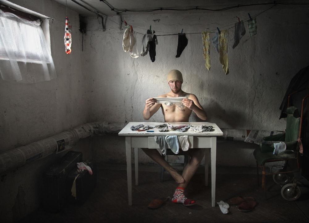 Photo in Random #odd #socks #chair #window #mood #man #light #color #table #wall #basement #poland