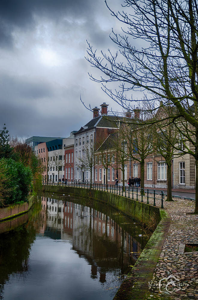 houses and reflection by Robert Stienstra