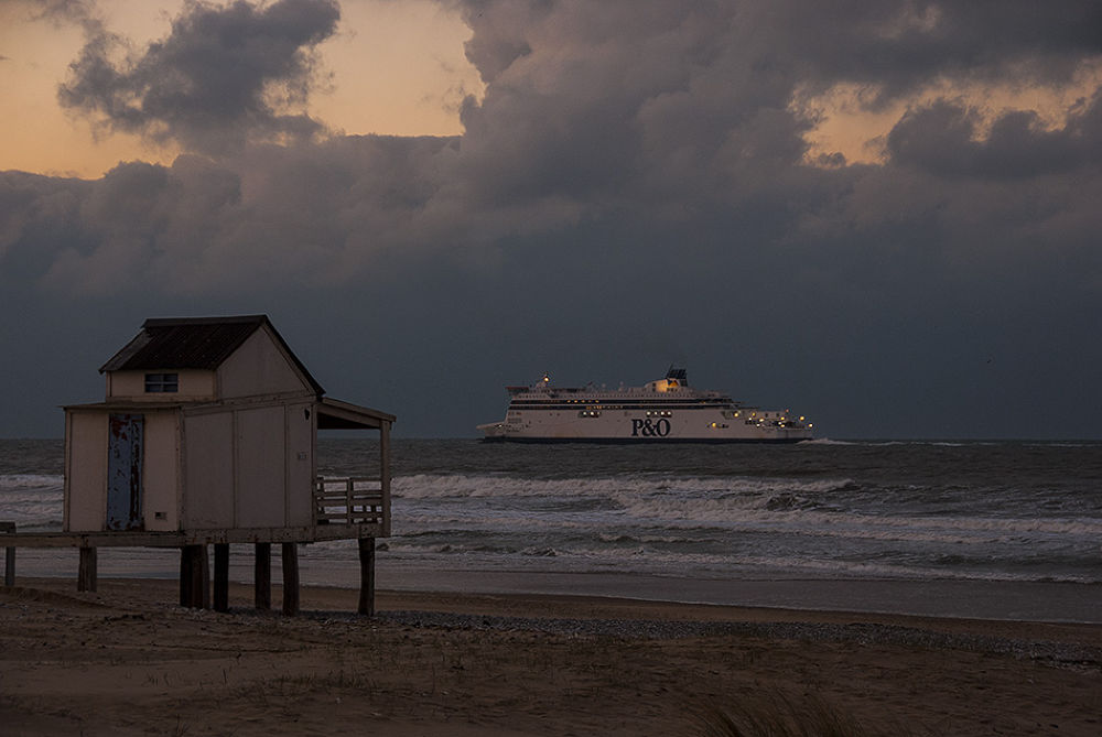 Photo in Sea and Sand #ferry boat #coast #france #sunset #beach house #beach #sea #north sea #calais #clouds