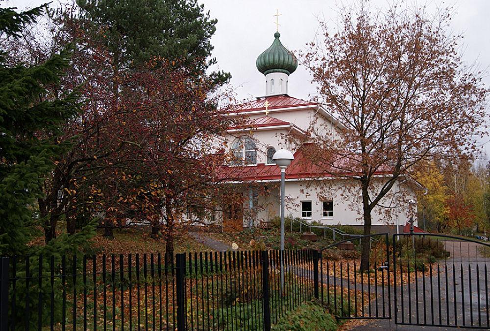 Front Side, Open Gate Empty Church by Heljä Kostiainen