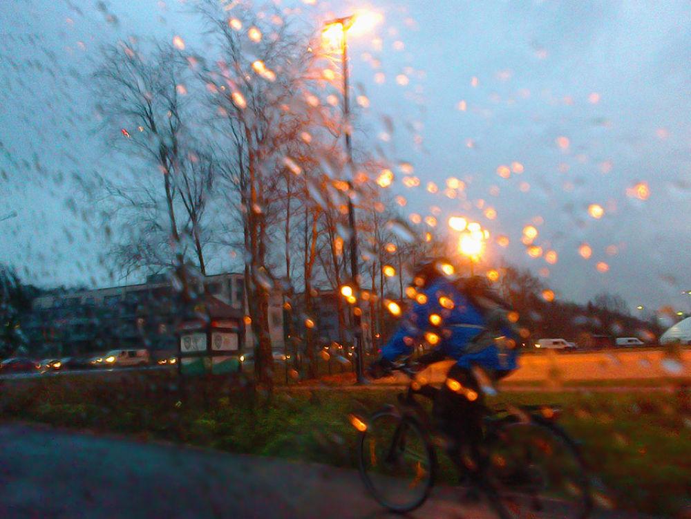 Cycling in The Rain by Heljä Kostiainen
