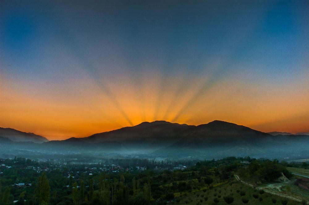 Photo in Landscape #landscape #sunset #goldenhour #baramulla #kashmir #trees #horizon #sky #sun #rays #mountains #ypa2013