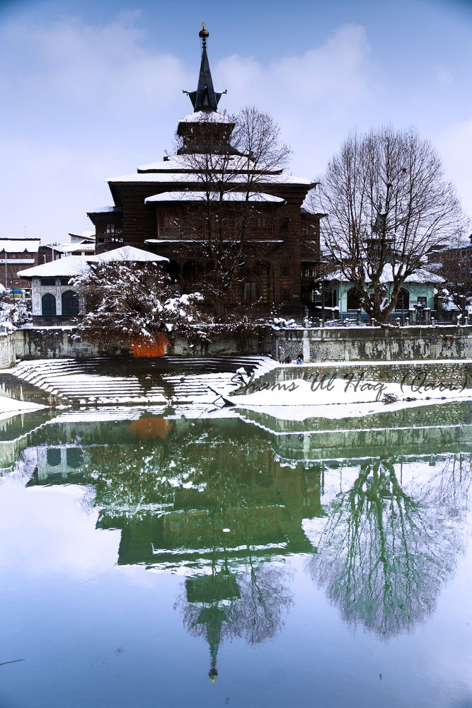 Photo in Architecture #architecture #snow #river #water #jehlum #kashmir #old #shrine #mosque #reflection #blue #sky #temple