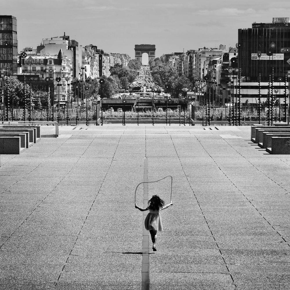 the girl with a jumping rope by Marcin Mi