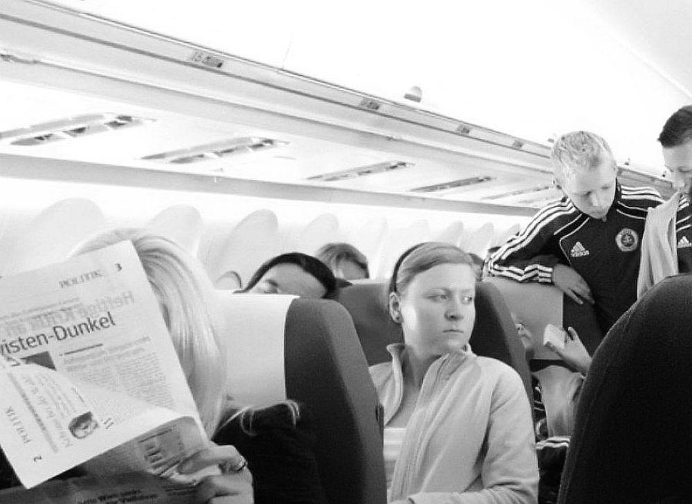reading a newspaper at the flight by Mulyatna Pakde
