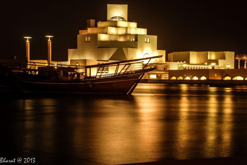 Photo in Architecture #doha #qatar #doha corniche #night photography #orange color #sea #boat #beautiful pictures