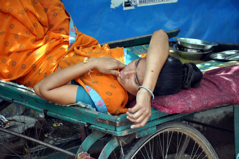 working women at rest  by kandukuri ramesh babu