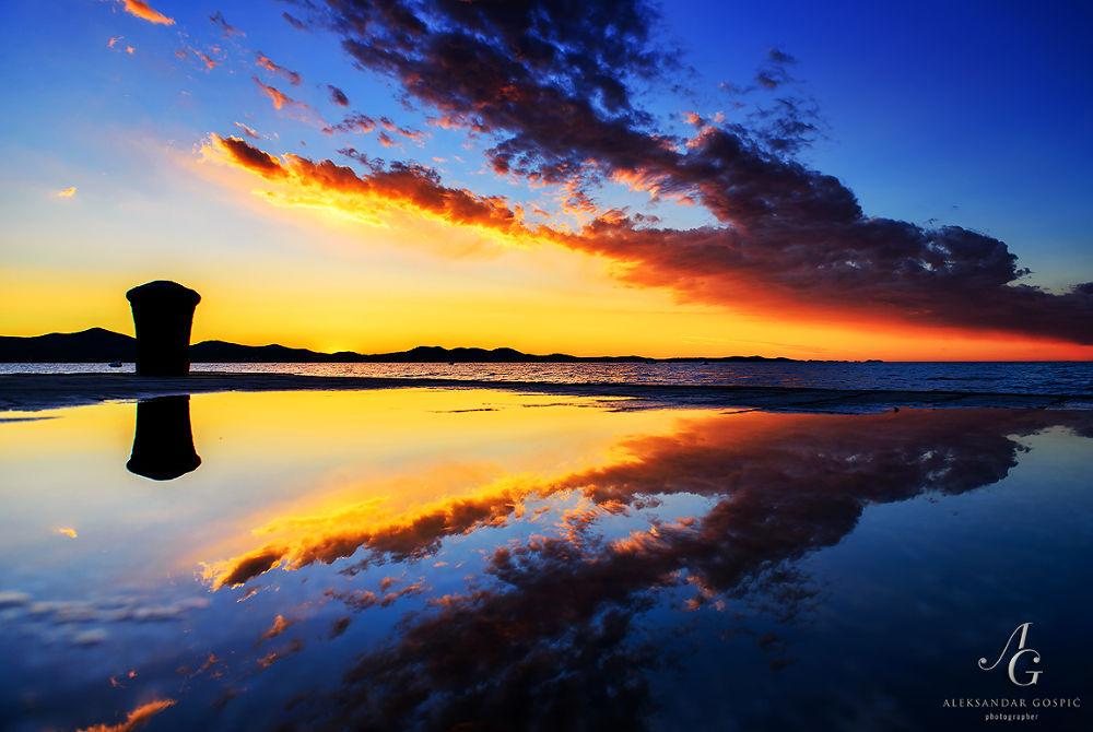 Photo in Landscape #zadar #dalmatia #croatia #sunset #waterfront #promenade #red #adriatic #puddle #reflection #mirror #color #clouds #blue