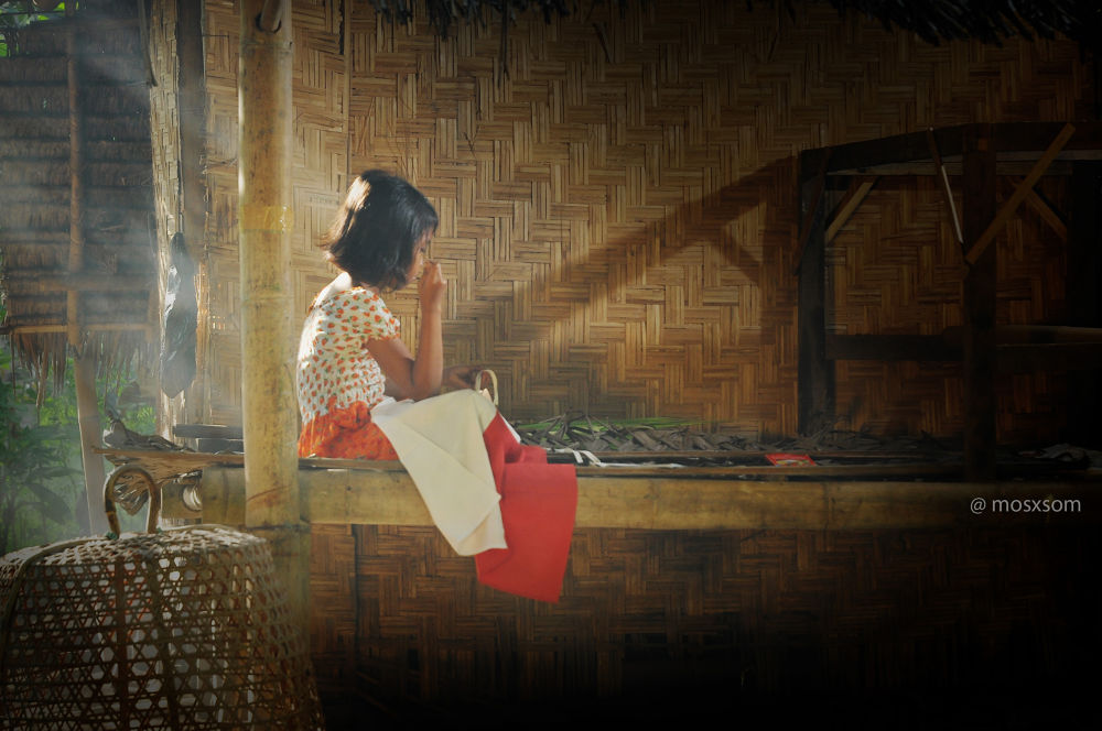 little girl fixing Indonesian flag by windiartha