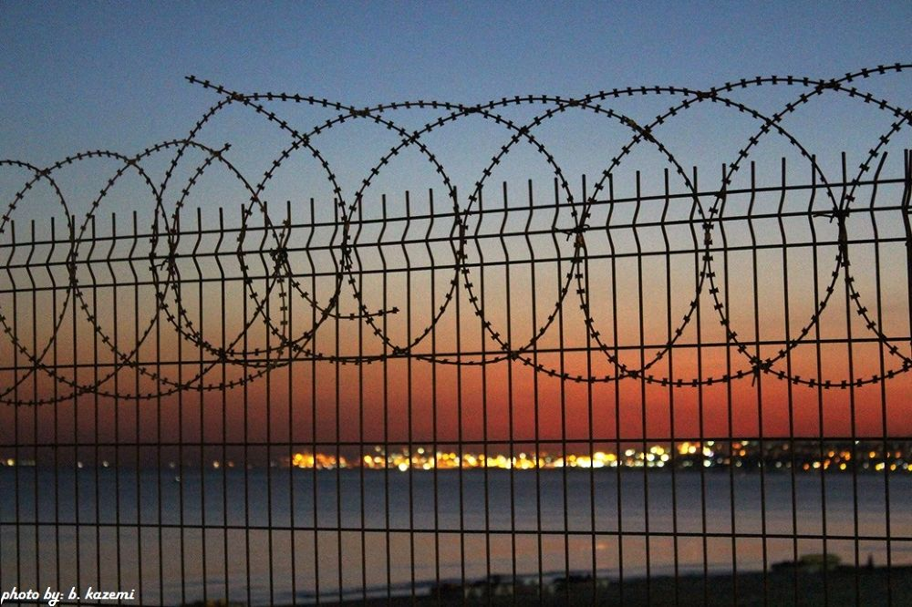 life in back of barbed wire by Behrooz Kazemi