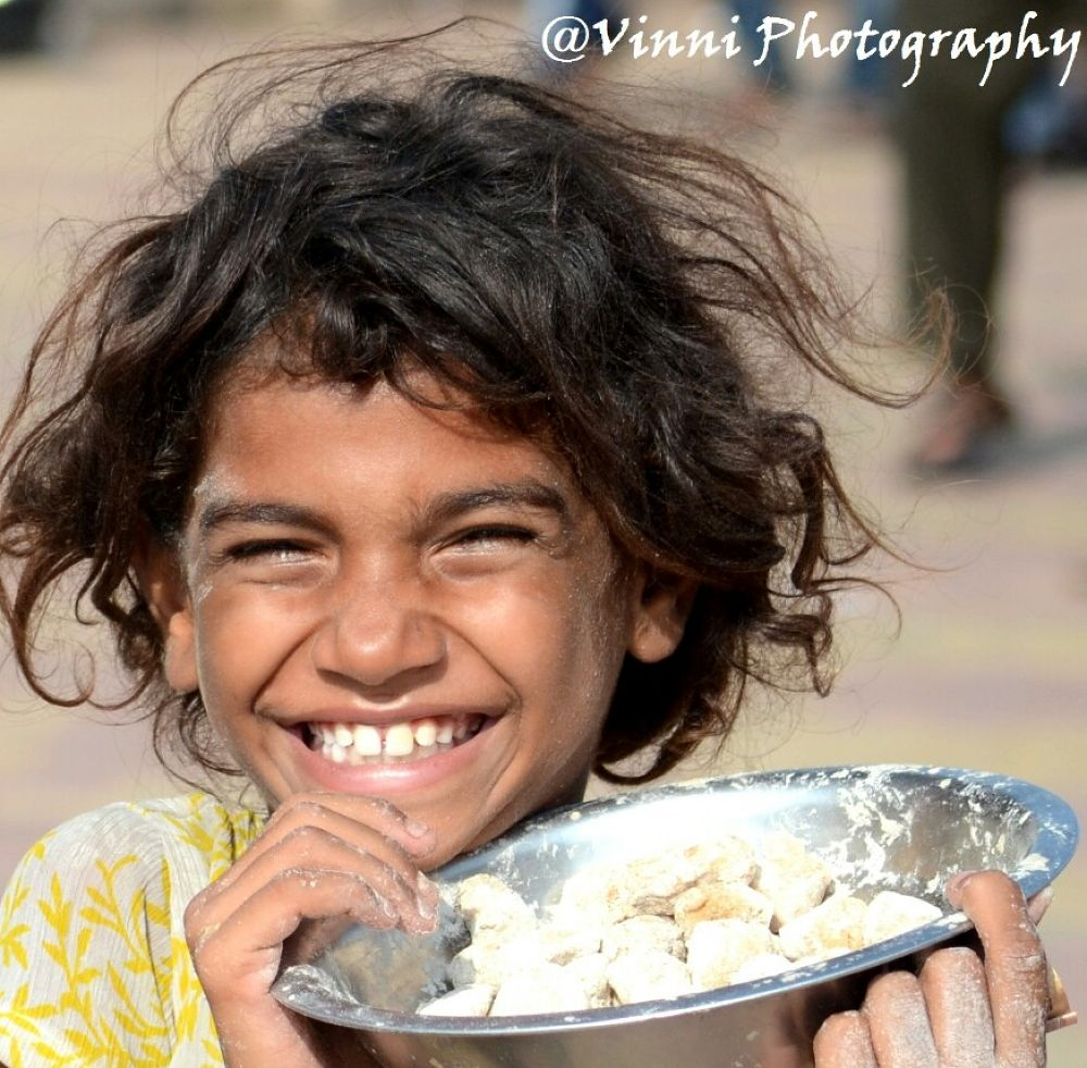 priceless smile by vineet chauhan