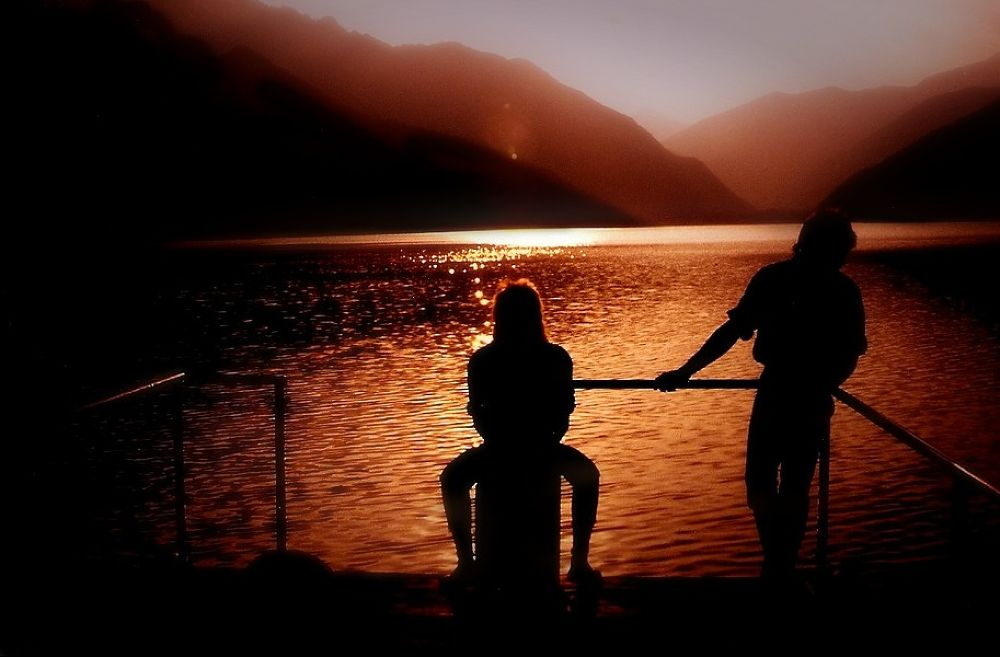 Photo in Family #sunset #water #lake #silhouette