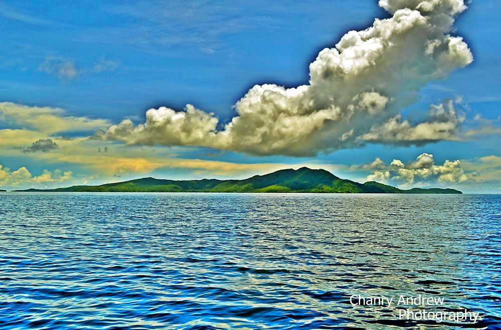 Beautiful clouds above the islands of Raja Ampat by Chanry Andrew