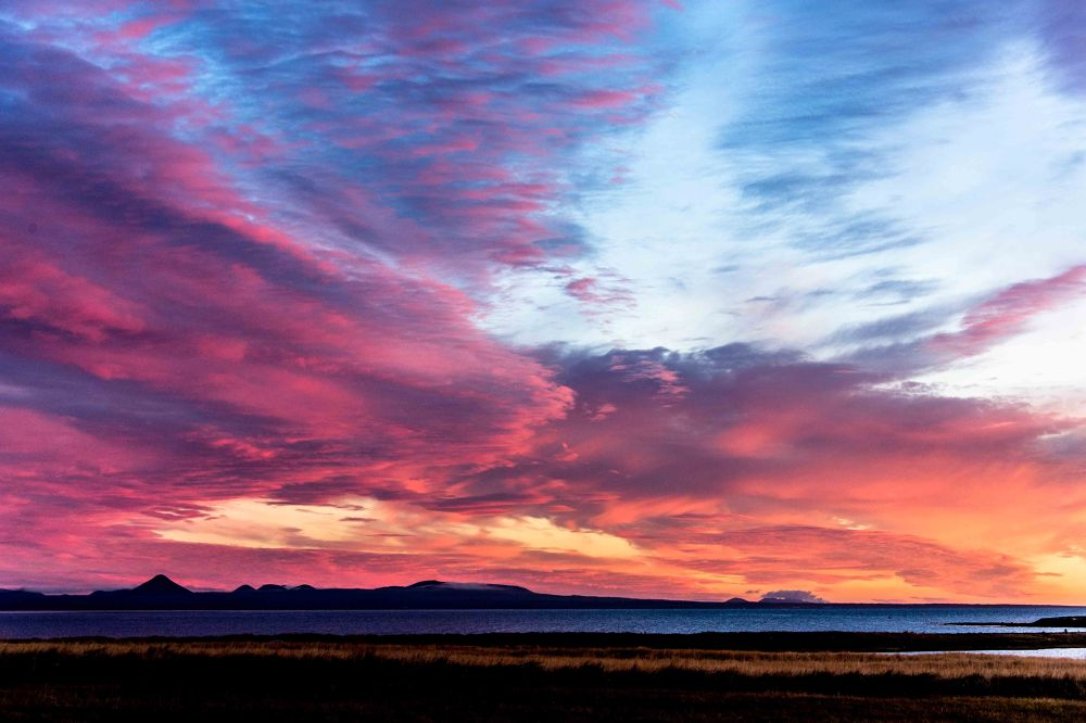 Photo in Random #sun #sunset #red #cloud #clouds #mountains #volcano #steam #sea #bay #ocean #island #iceland
