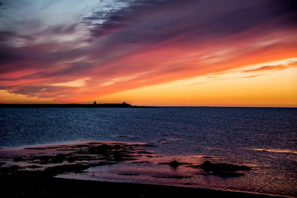Photo in Random #sun #sunset #water #sea #ocean #red #purple #yellow #rock #stone #bird #bay #pier #sky #clouds