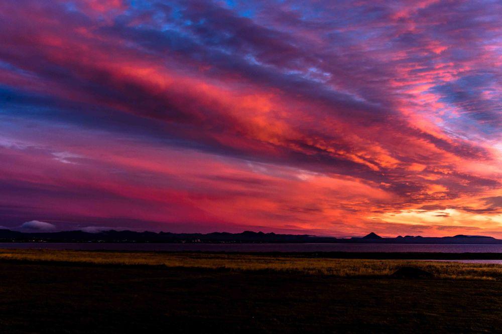 Photo in Random #sun #sunset #sky #clouds #red #sea #ocean #grass #mountain #volcano #bay