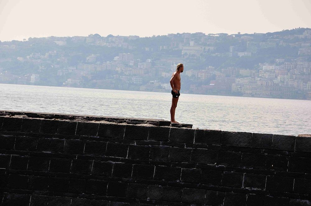 Photo in Street Photography #man #only #solitudine #reflection #sea #napoli #naples #wall #city