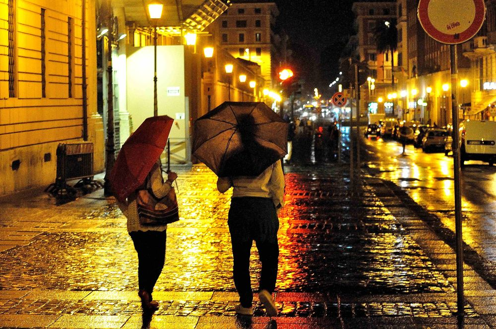 Photo in Street Photography #rome #love #umbrella #man #woman #rain #city #night #light #together