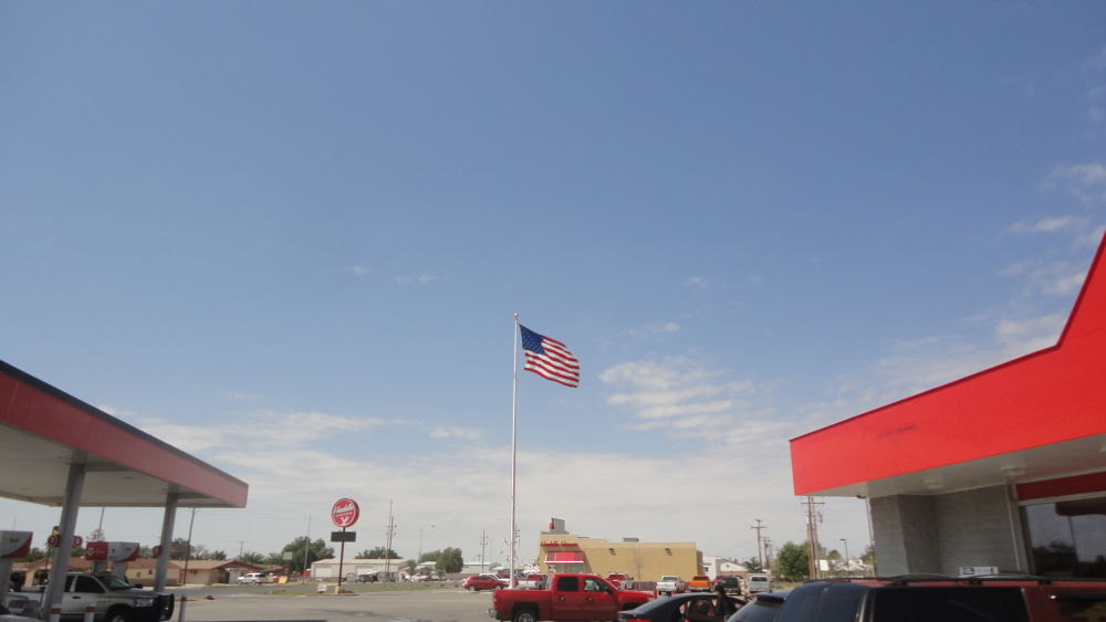 A Gas Station with United States of America's Flag by Tibu.Aguirre