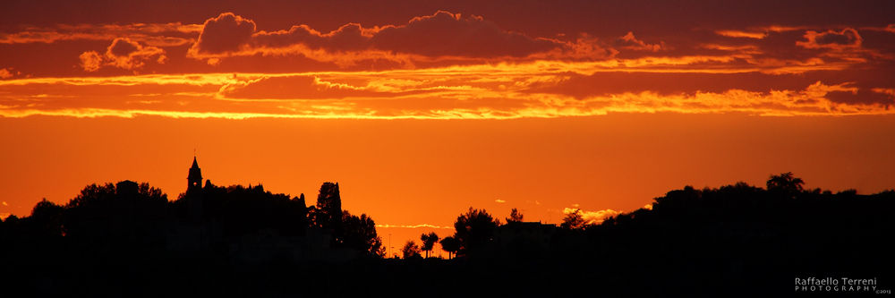 Fiery Sunset by Raffaello Terreni Photography