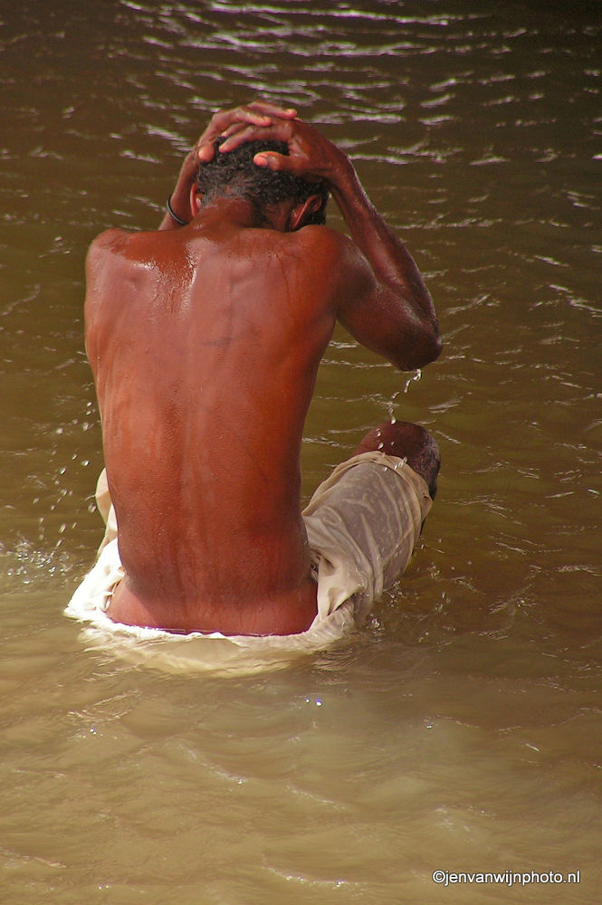 Photo in Portrait #washing man #dusty #rough life #camelriders #nile #river nile #sudan