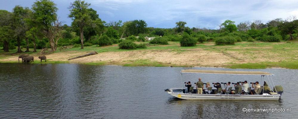Photo in Random #botswana #river #elephants #boat #water #photographers #camera's #safari boat #camera shoot