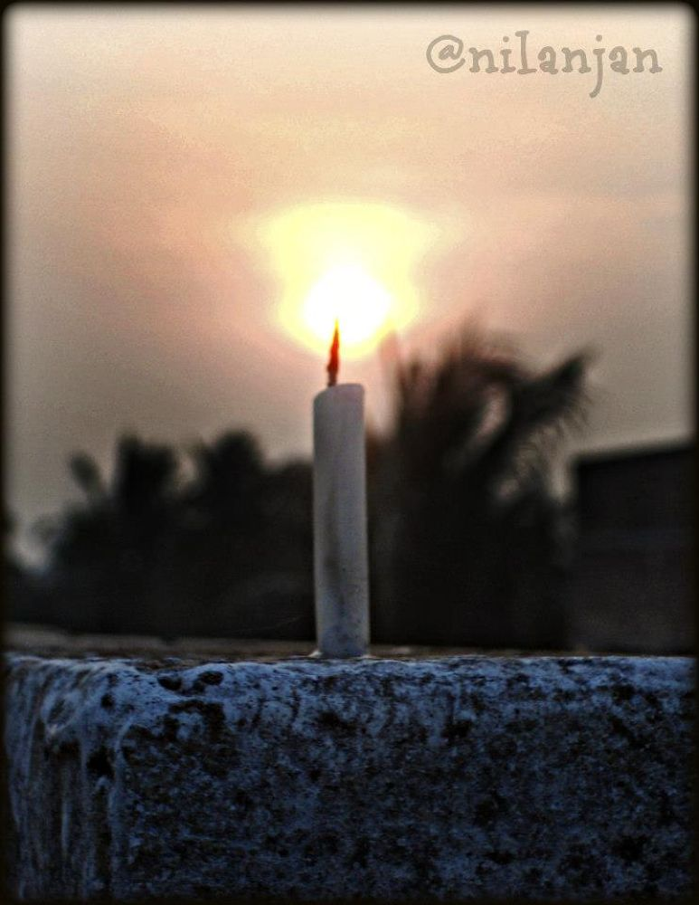 When the sun sets... no candle can replace it...  by Nilanjan