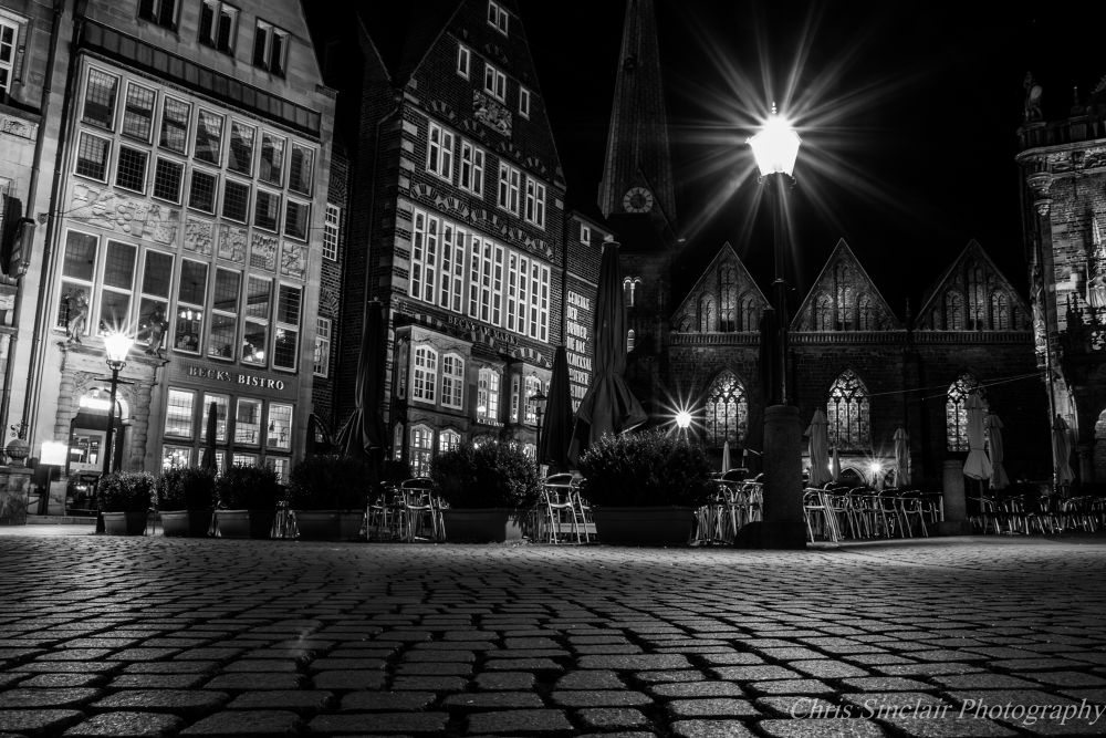 Photo in Cityscape #bremen #black and white #architecture #cobbles #seating #city #lights #night shot #night