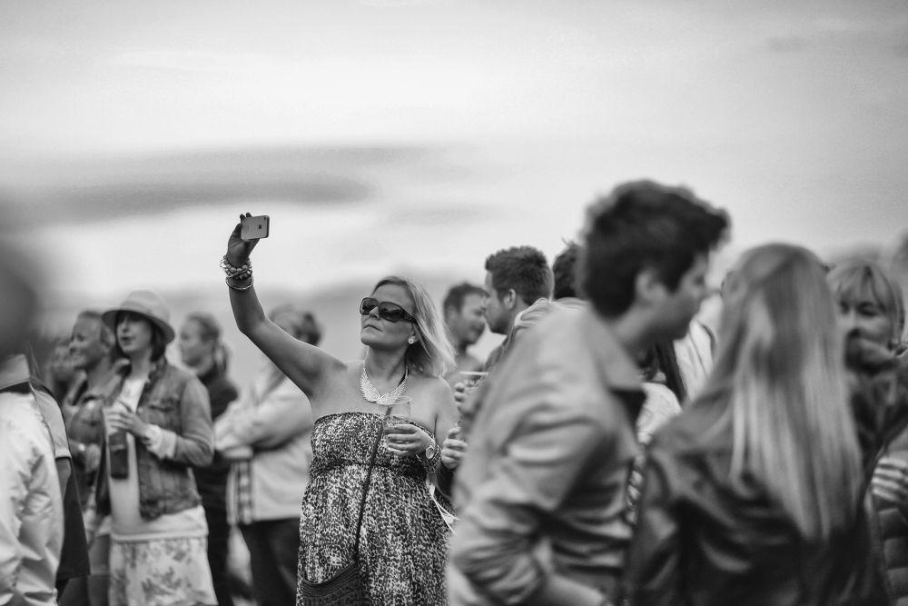 Woman with iPhone by MariuszMarczak