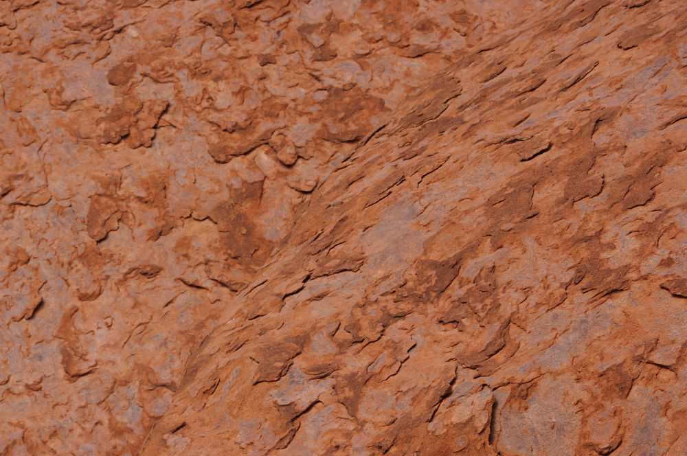 Peeling layers of Uluru by katherineannpotter