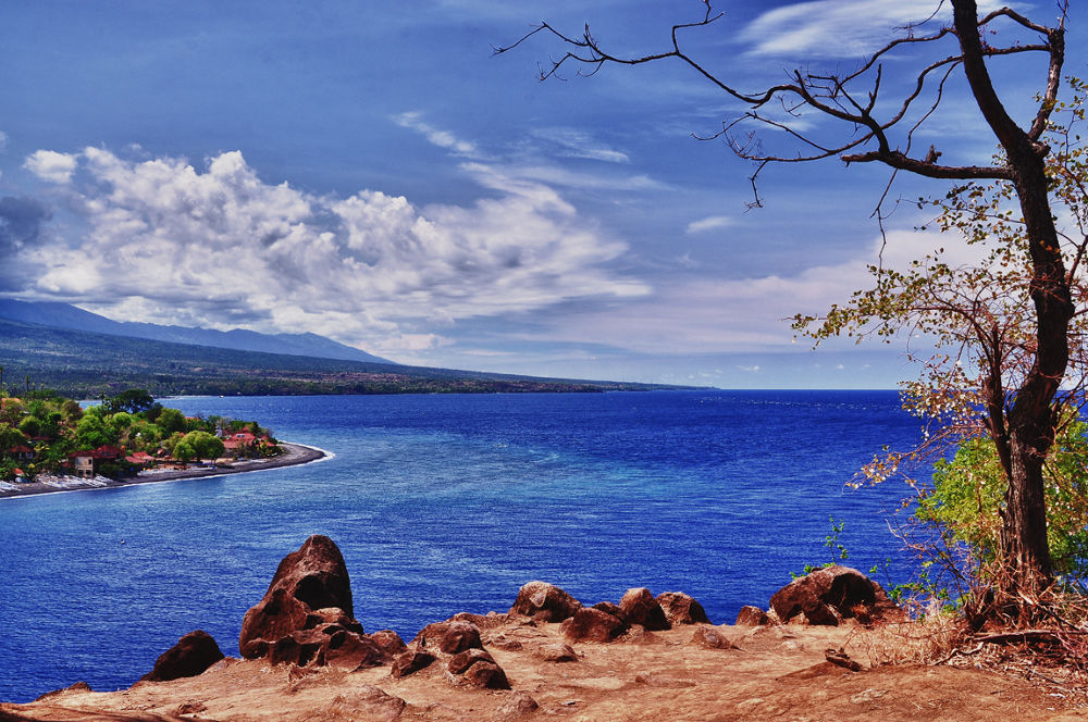 Photo in Landscape #amed #bali #beach #landscape #trees #sea #blue #sky #cloud #mountain #rock