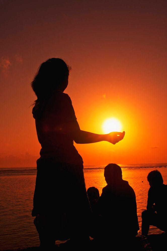 Holding the sunrise by nurdinrivai