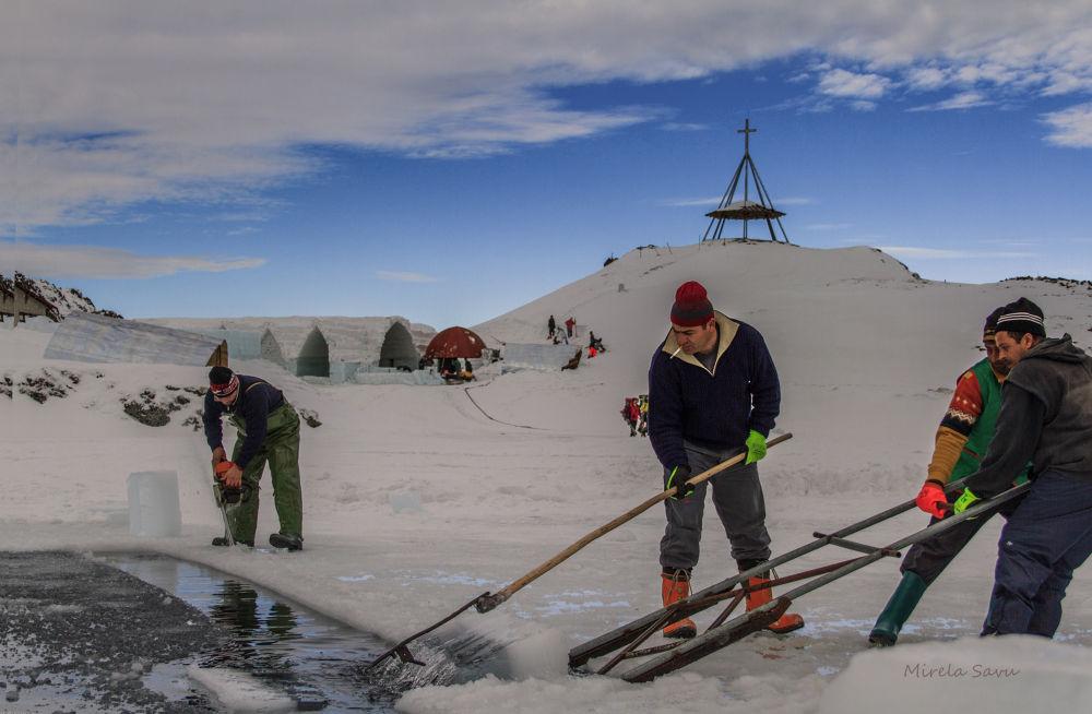 building the ice hotel  by Mirela Savu