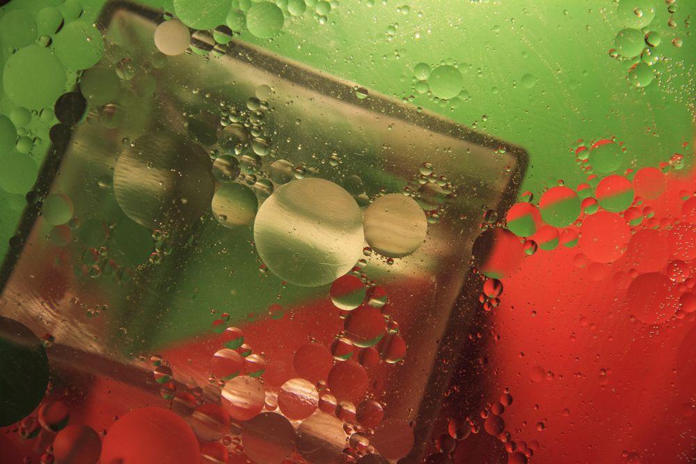 oil and water by Mirela Savu