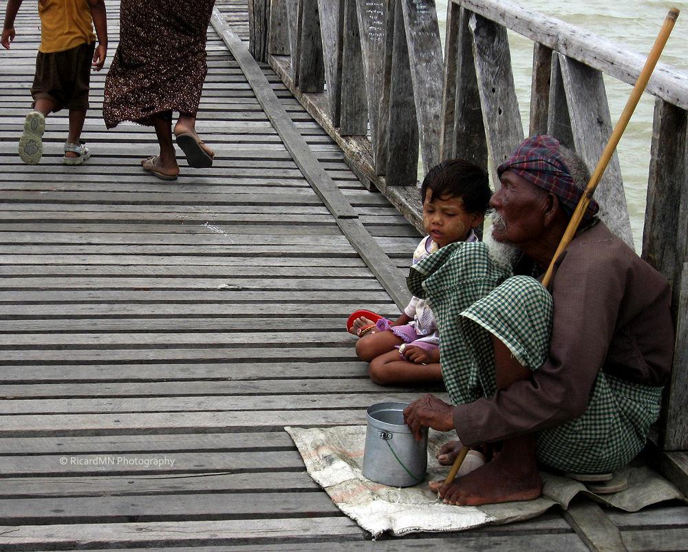 A beggar on the U Bein Bridge by RicardMN