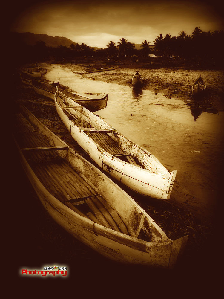 Pair Of Boats by Kusbian Indradi