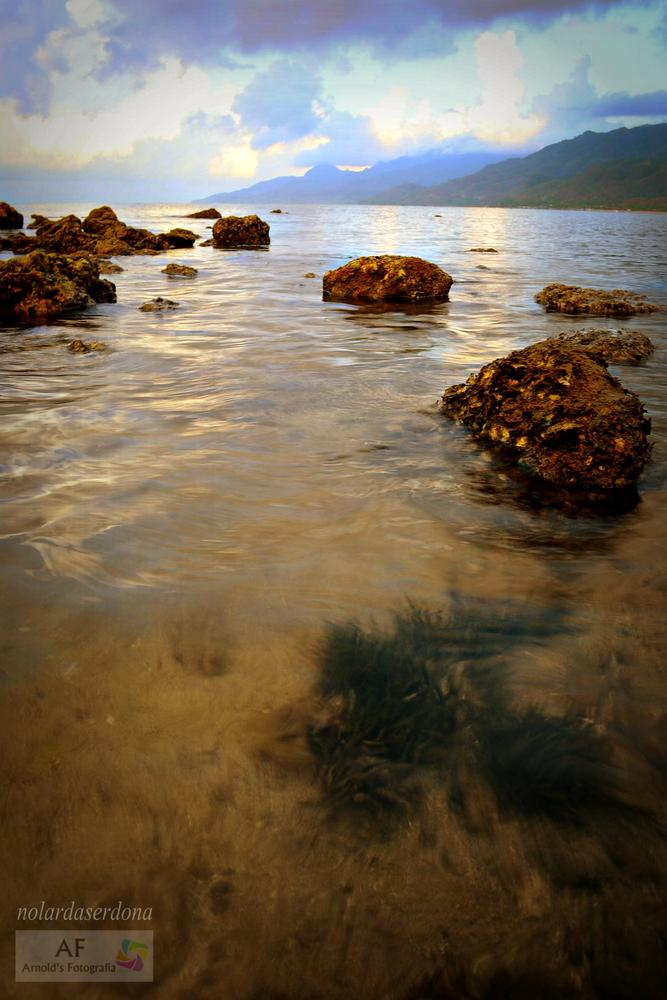 Clear morning waters of One Laiya by Arnold Reasonda